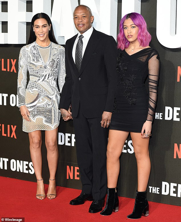 Dre is currently in the middle of a messy divorce and is attempting to work out a settlement with his estranged wife Nicole Young who is looking to receive $2 million a month from him; seen with Nicole, left, and daughter Truly, right, in 2018