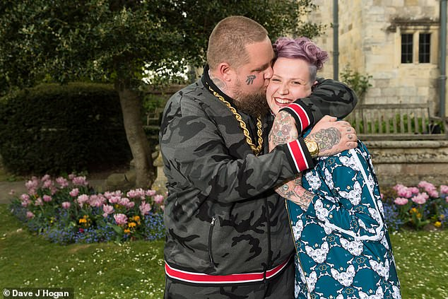 Ending on good terms: Rag'n'Bone man, real name Rory Graham, and Beth were said to have parted ways 'amicably' (pictured in their wedding tracksuit attire)
