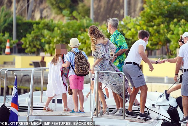 Out at sea: The singer, 46, headed out on a boat ride with his wife Ayda Field, their children and pals on Friday