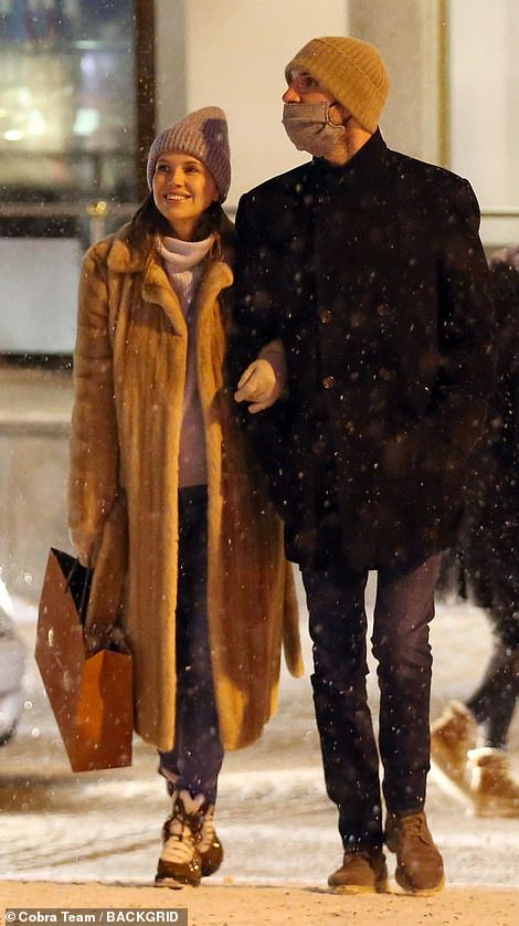 The Moscow-born gallery owner, 39, who is the ex-wife of billionaire Chelsea football club owner Roman Abramovich, 54, wrapped up in a fur coat for a shopping trip with Stavros, 35, in St Moritz