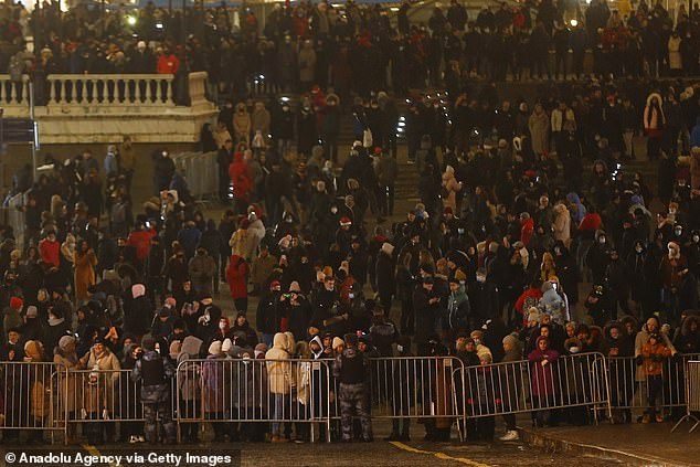 Citizens arrive to watch fireworks show at the Manezhnaya Square in Moscow on New Year's Eve