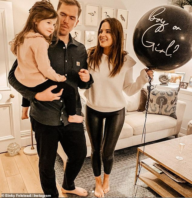 It's a boy! Binky went on to admit that she hopes this will not be her last pregnancy as she wants a big family of about 'three or four' children (Binky, Max and her daughter India pictured during their gender reveal)