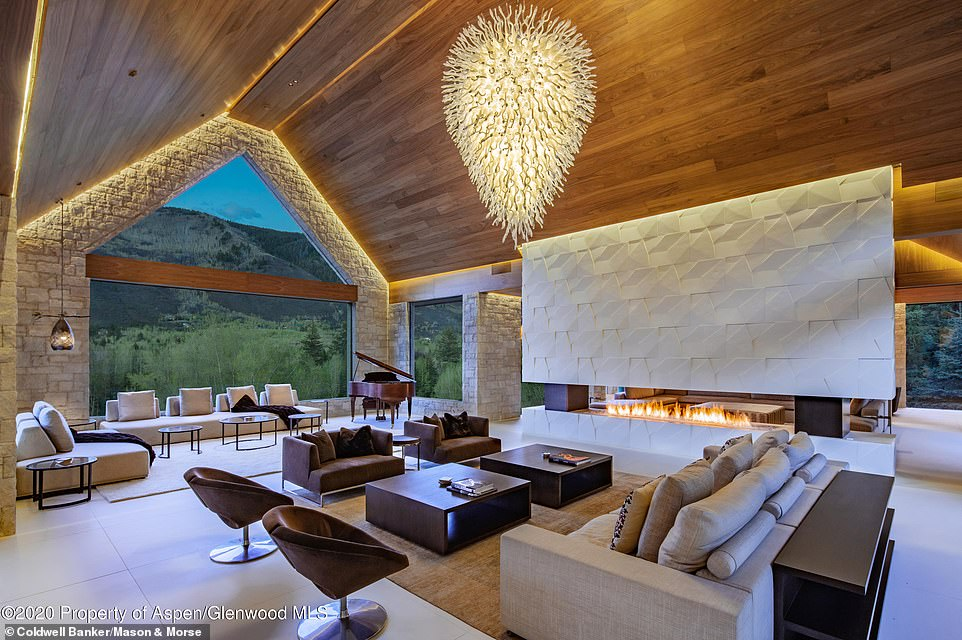 Stylish: The interior is decorated with tasteful cream-colored stone with inviting wood accents