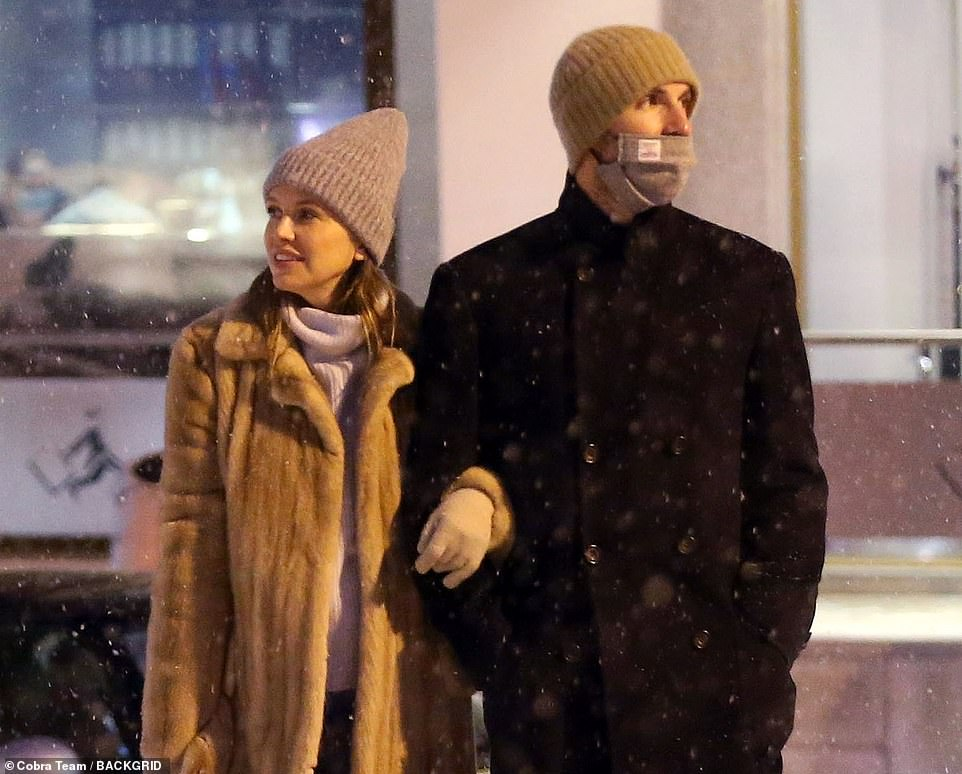 Loved-up: The couple strolled arm-in-arm through the snow before popping into an Italian boutique