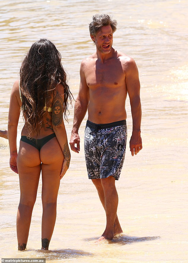 Coming in hot:Lee and Gabriella wasted no time during Sydney's heatwave, heading to their nearby beach to cool off