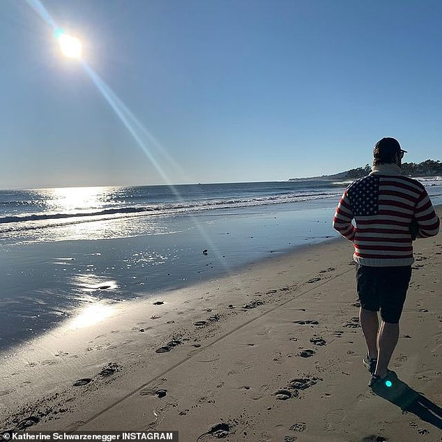 Ocean air: She posted a photo of her Guardians Of The Galaxy husband walking on the beach in a very patriotic sweater
