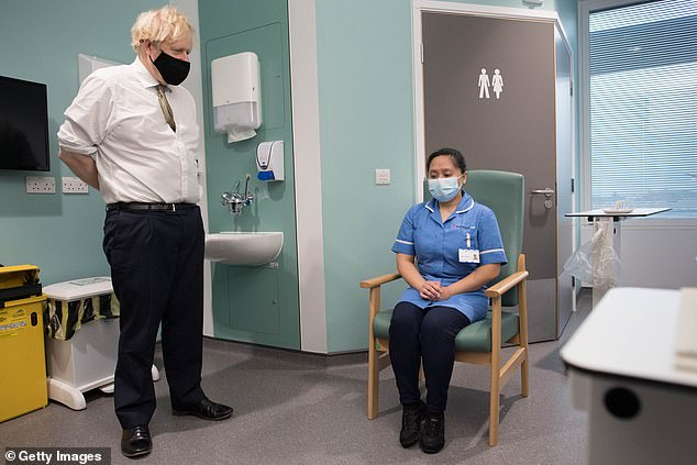 Boris Johnson pictured visiting the Chase Farm Hospital in London yesterday