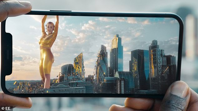 Not-so-golden girl: The advert saw Rita dancing and singing to her single Let You Love Me among London's picturesque skyscrapers, clad in an eye-catching gold jumpsuit. as an 'AR avatar'