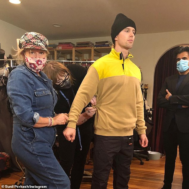 Fitting: Mona (L) also costumed Pretty Little Liars alum Drew Van Acker (M), who promised the film was 'special' on Thursday and called it 'hard work under extreme circumstance' (pictured November 18)