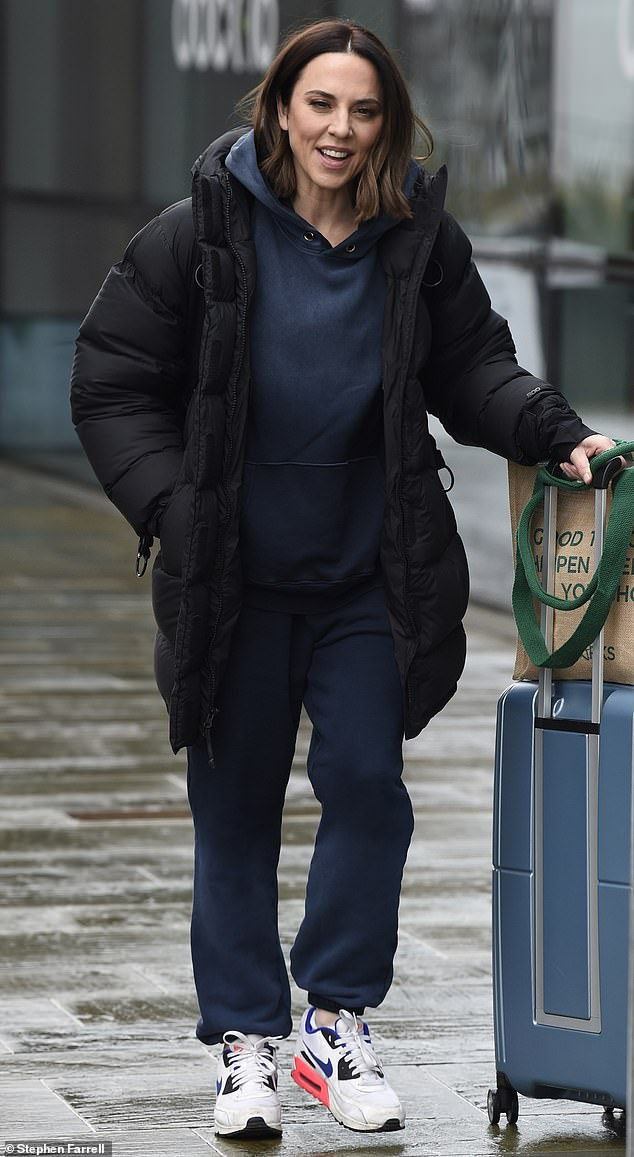 Radiant:The Spice Girl, 47, put on a cheery display as she flashed a smile while leaving a TV studio in the British city