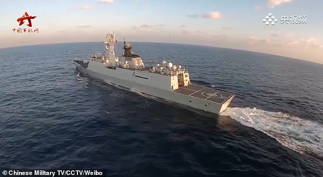 Multiple warships are seen sailing at sea duringtraining in 'real combat conditions' in the video
