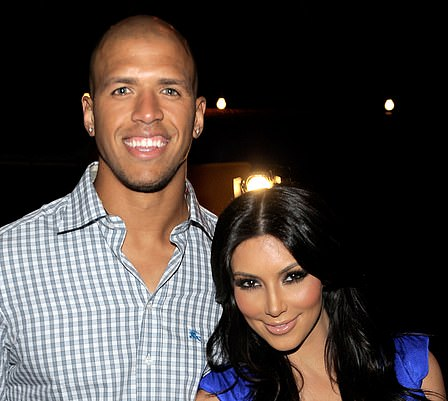 Romance: Moving on from Reggie, Kim fell into the arms of another NFL player, Miles Austin who she dated from June to September 2010 (pictured July 2010)