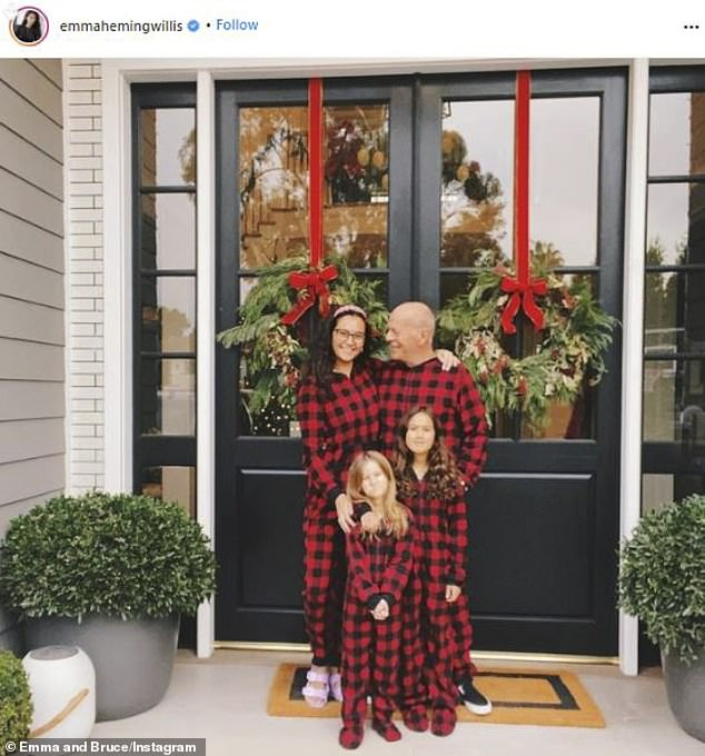 His tribe: Bruce Willis rarely shows photos with his wife Emma and their two daughters. But on Christmas day he did just that as the 65-year-old actor posed proudly with Evelyn, aged six, and Mabel, aged eight, in front of a Christmas tree