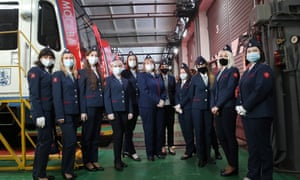 Female train drivers pose for a group photograph in the maintenance depot on Line 4 (Filyovskaya Line) of the Moscow metro.