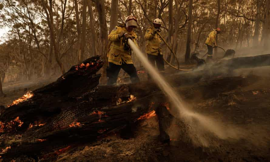 Firefighters try to contain a blaze in New South Wales last February.