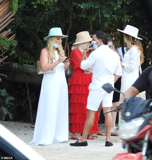 Style: The TOWIE star, 38, looked radiant in a loose-fitting white jumpsuit and a wide-brimmed hat, with Frankie, 33, echoing her laidback look in a flowing white dress and matching hat