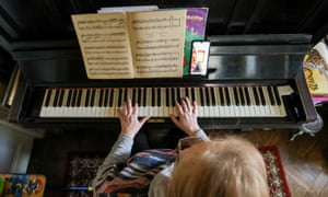 A piano teacher duing a remote lesson earlier this year.