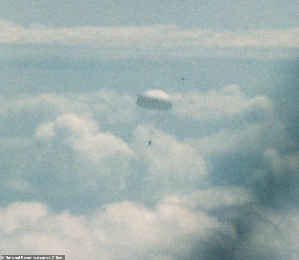 After completing 145 missions and returning 120 film canisters, the program was decommissioned in 1972 because newer satellites were capable of beaming images directly back to Earth. Pictured is one of the film canisters falling back to Earth