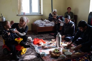Abdilla Tashbekov and his family have lunch at home in Sary-Mogol.