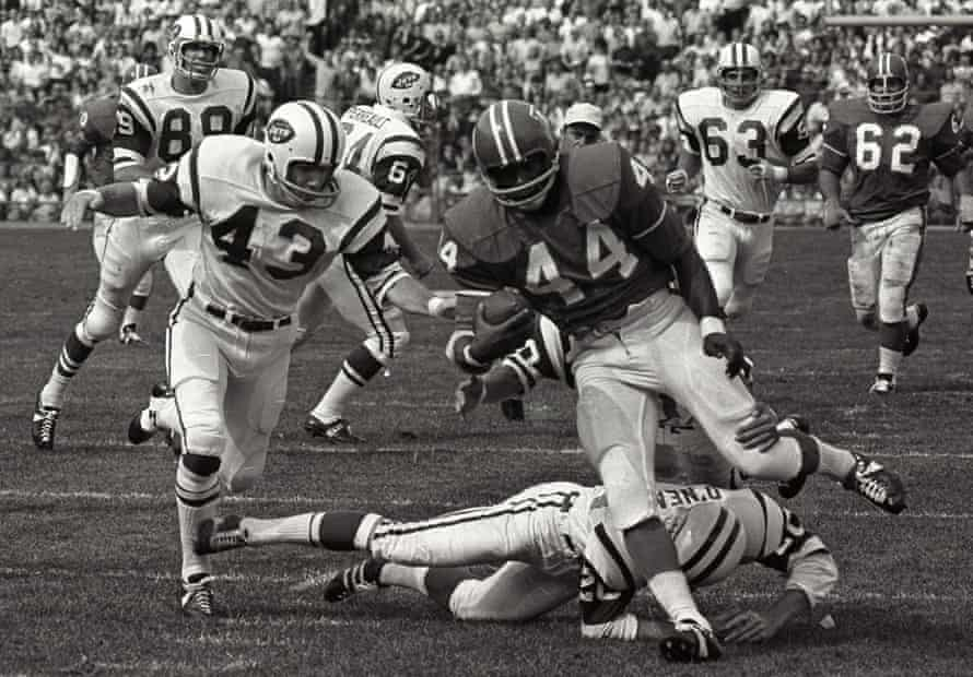 Little avoids a tackle from the New York Jets' Steve O'Neal in Denver, in 1969.
