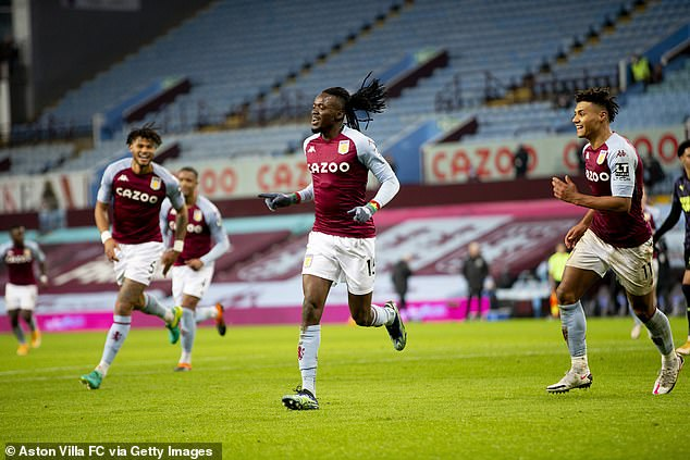 Bertrand Traore of Aston Villa scores against Newcastle United at Villa Park on January 23, 2021, with rows of empty seats in the background due to the viral pandemic