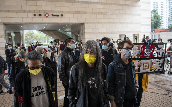 """""""Long Hair"""" Leung Kwok-hung (M) and Figo Chan(R) are seen entering a Hong Kong court in December. Leung Kowk-Hung , Figo Chan, Tsang Kin-Shing , former lawmaker Eddie Chu and Wu Chi-wai are all charged with crimes related to the Anti-National Security Protest on July 1, 2020 ."""