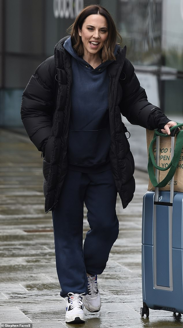 Low-key:Mel C cut a low-key figure in a loose-fitting blue tracksuit with an oversized hoodie and matching bottoms
