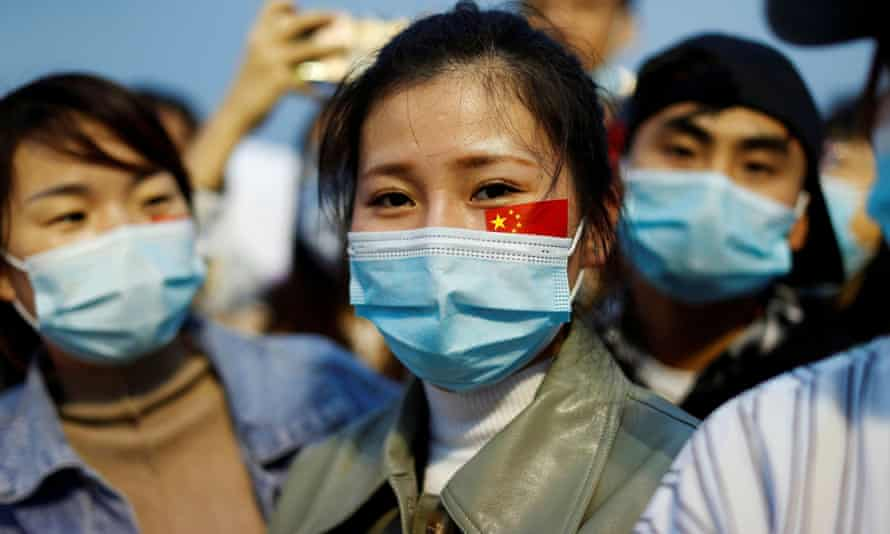 People wearing face masks at a Beijing ceremony to mark the 71st anniversary of the founding of People's Republic of China in October.