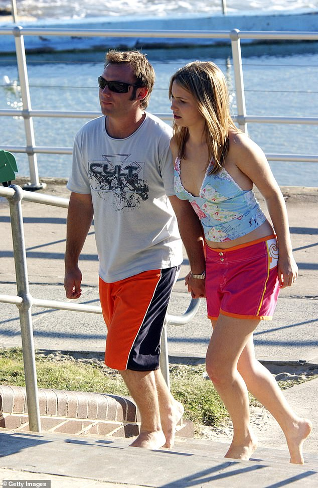 Back in the day: Sam is pictured with his co-star Christie Hayes while filming scenes for Home and Away at Sydney's Bondi Beach onMay 3, 2004