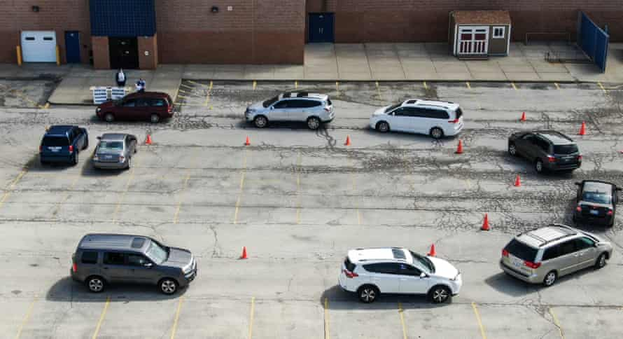 A queue of vehicles lining up to receive iPads and Chromebook laptops for students to use in remote learning at Indian Hills Elementary School in Round Lake Heights, Illinois, in April last year.