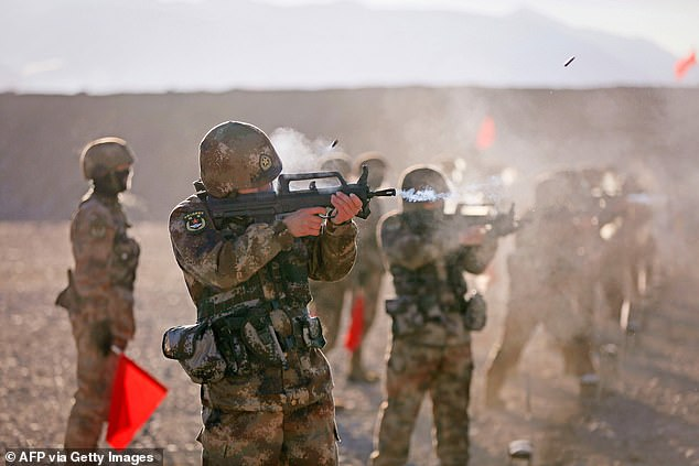 Speaking to South China Morning Post, Hong Kong-based military commentator Song Zhongping said: 'China is indeed facing a great risk of war, which has been seriously implied in this order.' Chinesesoldiers are seen taking part in military training in Kashgar on January 4