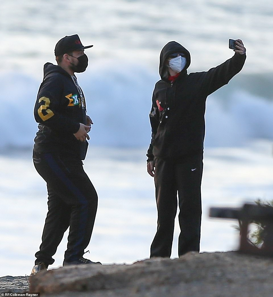 Capturing the moment:At one point, Miley paused to take a selfie that featured the gorgeous Malibu shoreline as its backdrop