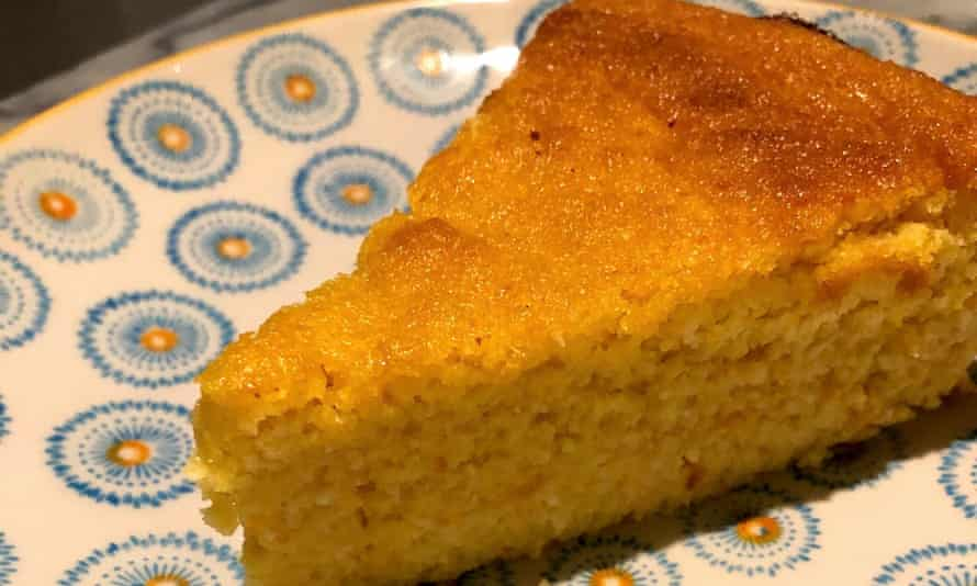 A slice of orange and almond cake on a plate