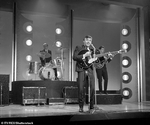 The band were the first ever act to reach number one in the UK charts with their first three single releases [pictured in 1963]