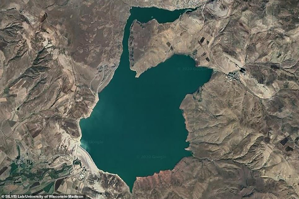 Decades later, an image shows a large body of water at the center of the region.