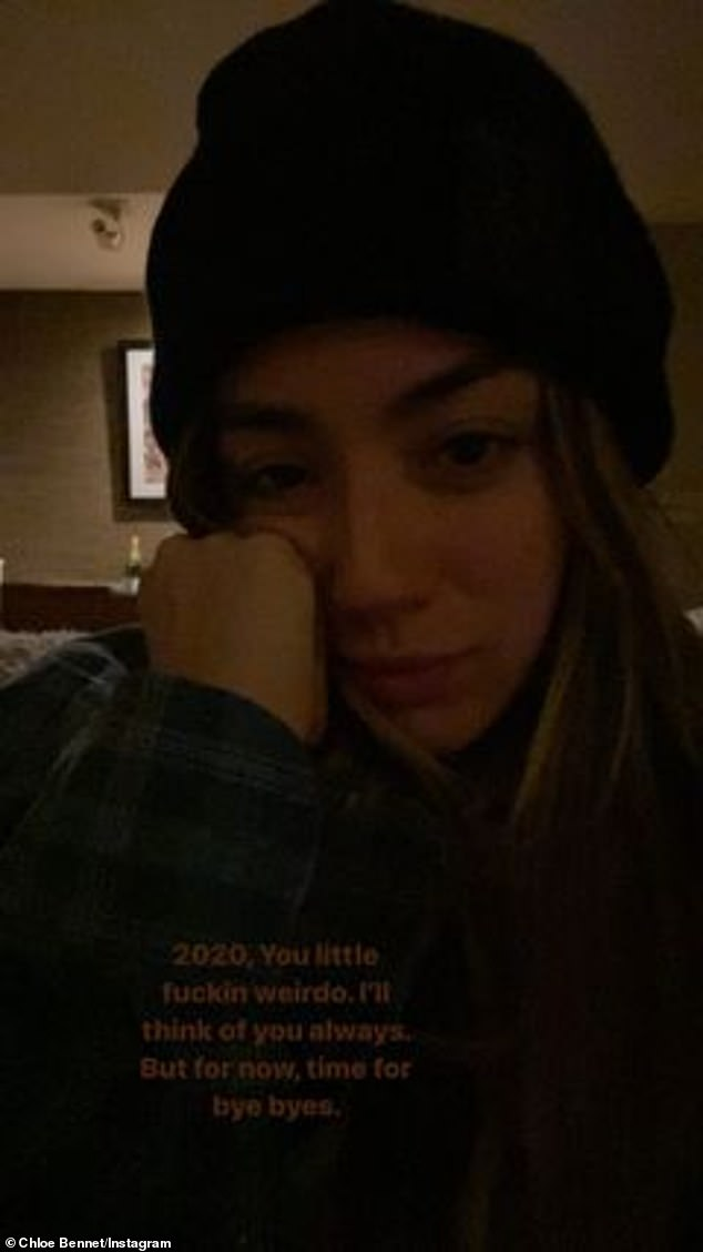 Pushing through: Additionally, the beauty also shared a snap of herself wearing a beanie and looking tired as she pressed one hand on her cheek and called 2020 a 'little f**kin weirdo'