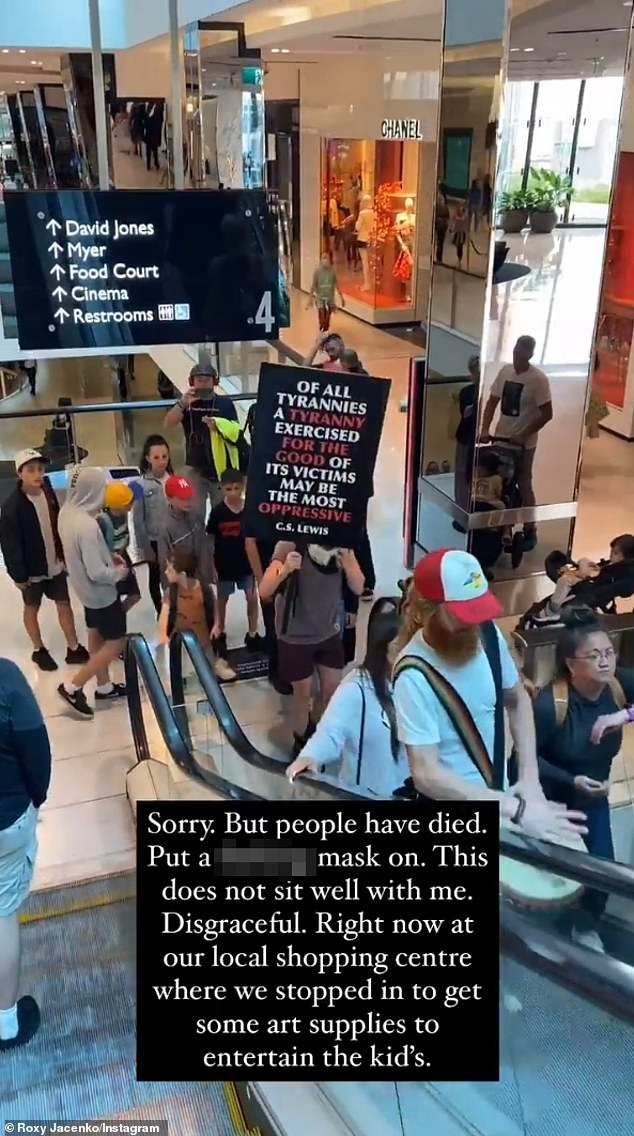 Scenes:The PR maven shared video footage she shot inside a local shopping centre, showing maskless, bongo-playing protesters brandishing signs and singing on an escalator