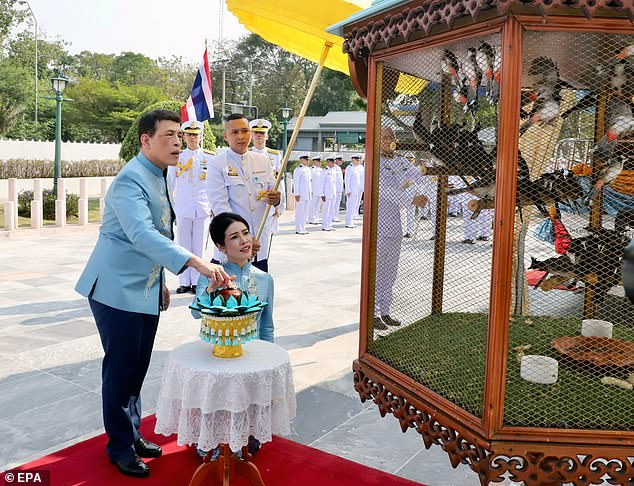 Vajiralongkorn and Sineenat release birds during a merit-making ceremony to mark the Royal Consort's birthday at Wasukri pier in Bangkok
