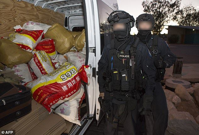 AFP officers are pictured after seizing the record quantity of meth in Western Australia in 2017