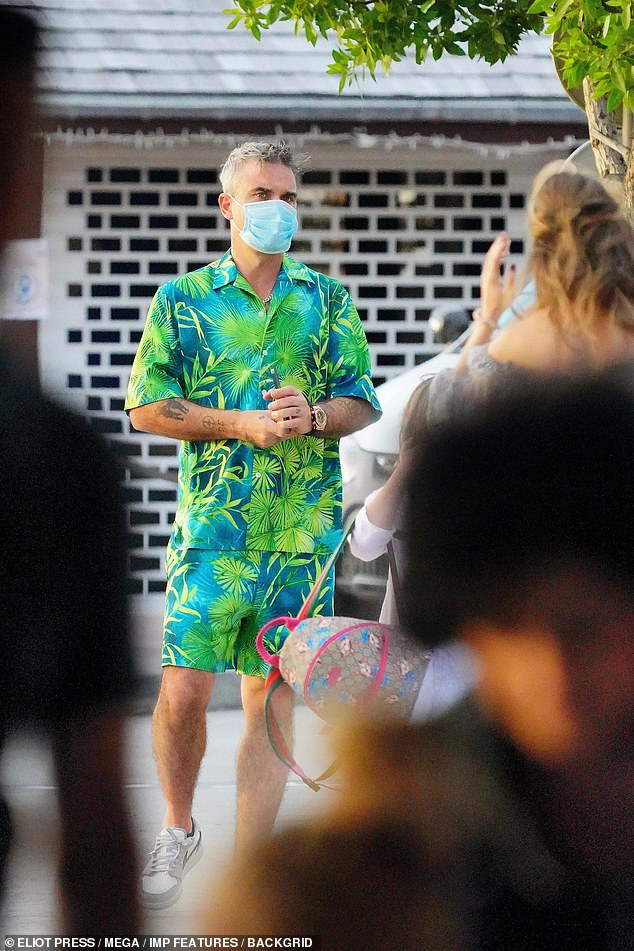 Living the life: Robbie looked like he had caught a tan after spending the festive period in St. Barts