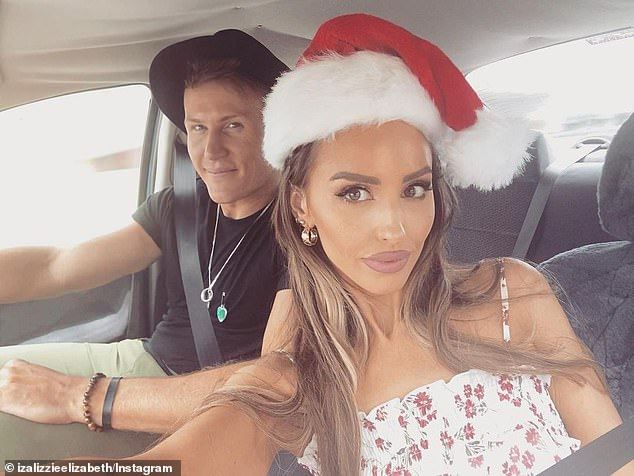 Holiday heartbreak: The last photo of the couple was posted on December 26, which showed a festive-looking Elizabeth wearing a Santa hat while cosying up to Seb for a car selfie