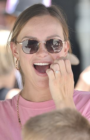 Stunning: Her sparkler was an elegant emerald cut diamond set in a halo ring