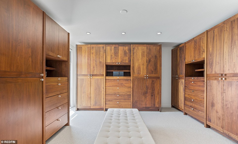 Closet space: The beautiful master suite spans the width of the house, featuring its own sitting room, a vast dressing room with wooden wardrobes and a luxurious bathroom