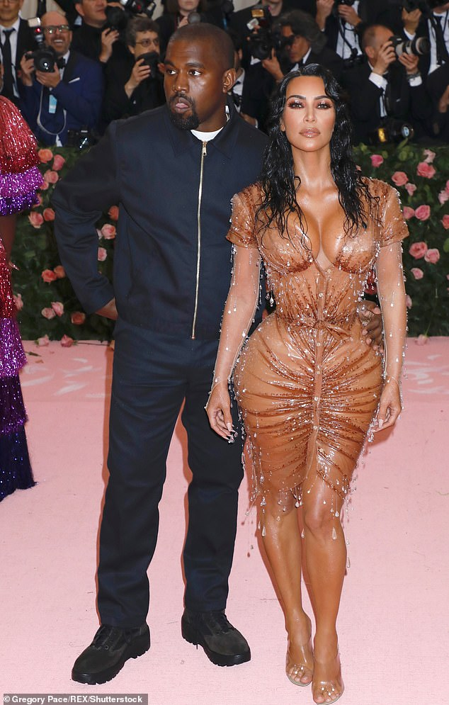 Holding on: Last month it was claimed that Kim and Kanye were still together but 'living separate lives' after a difficult year