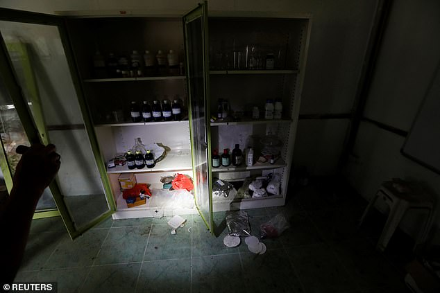 A small meth lab, which police suspect was used to experiment with new recipes, is seen inside a raided compound belonging to Sue Songkittikul, a suspected Sam Gor syndicate operations chief
