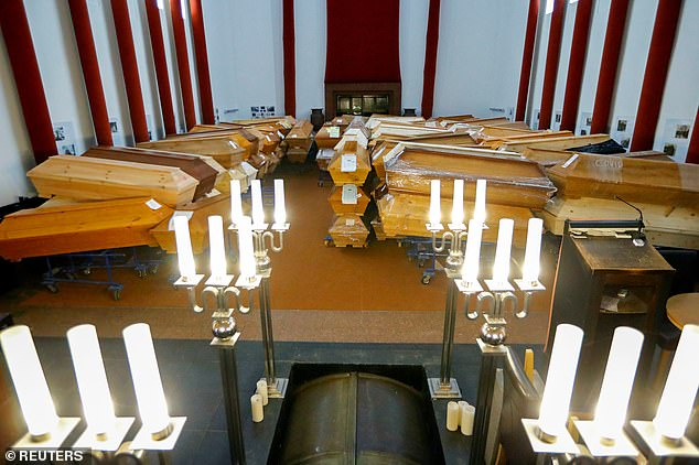 Coffins of coronavirus victims are piled up in a crematorium in Meissen today as Germany suffered a third straight day of 1,000 or more deaths