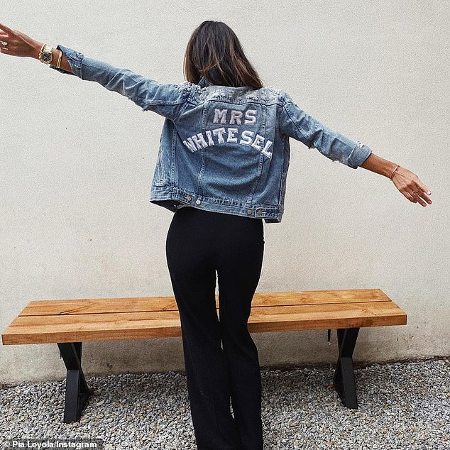 'Can't wait to be Mrs PW!':Late last month, the glamazon sent the rumour mill into meltdown when she emerged on Instagram wearing a custom-made denim jacket emblazoned with the words 'Mrs Whitesell' on the back