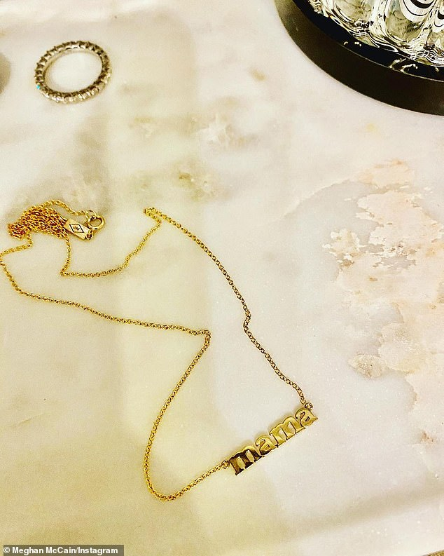 'I only wished I had done this sooner':Meghan reflected on the joys of motherhood in a heartfelt post she shared to Instagram, which included a photo of a gold 'Mama' necklace
