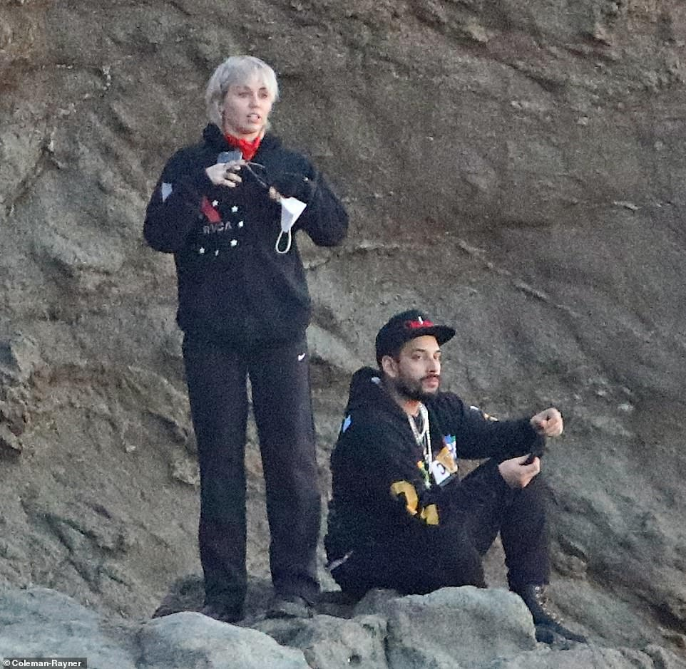 Best view:Wanting to get the best view of the coastline, Cyrus and McBeek carefully scaled a seaside rock formation and took a seat