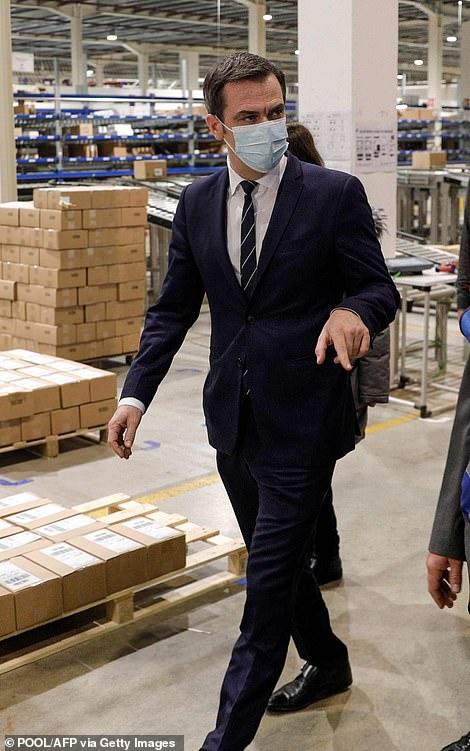 France's health minister Olivier Veran at a vaccine distribution hub near Paris